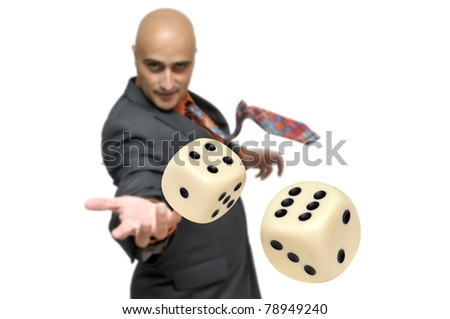 Man in a suit playing dice isolated in white - stock photo