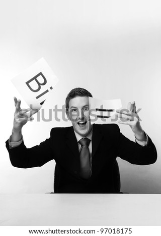 man in a suit sat at a desk just ripped up  a  piece of paper up with the word bill printed on it and now throwing it away - stock photo