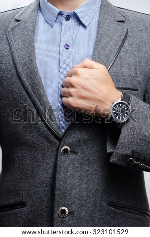 man in a suit shows a wristwatch - stock photo