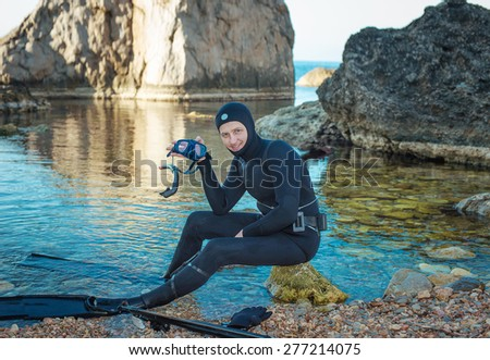 man in a suit underwater hunter, - stock photo