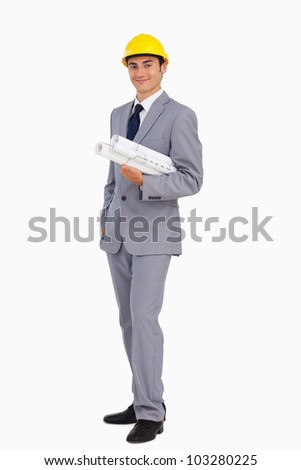 Man in a suit with safety helmet and plans against white background