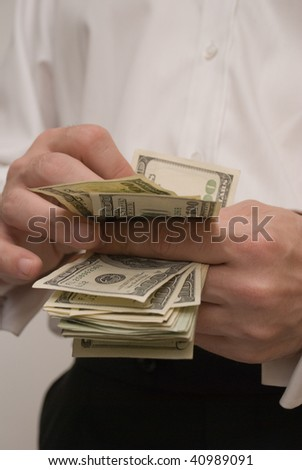 man in a tux counting money