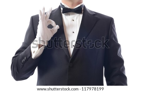 man in a tuxedo gesturing everything is ok isolated on white