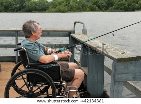 Man in a wheelchair fishing from a handicapped accessible fishing pier