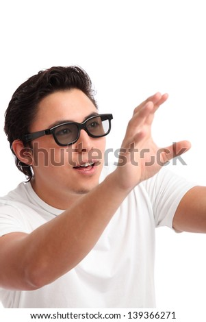 Man in a white t-shirt wearing 3D glasses, watching. White background.