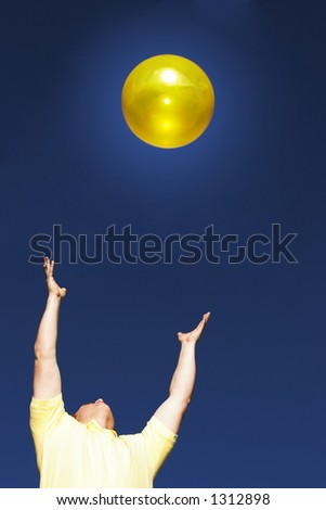 Man in a yellow shirt with his hands out connecting with the good - stock photo