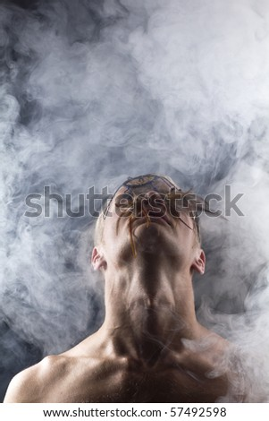 Man  in abstract smoke - stock photo