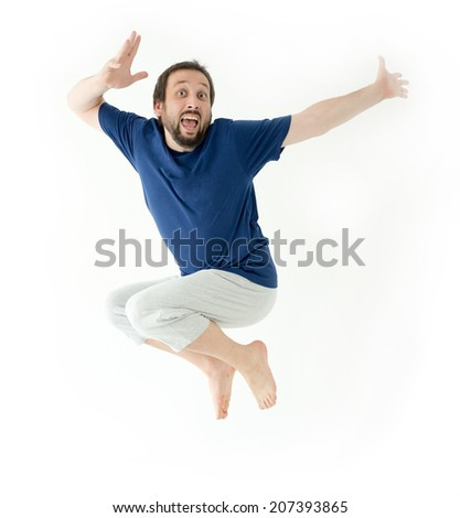 Man in air jumping and making gestures and expressions - stock photo