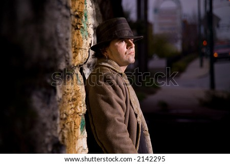 Man in alley waiting - stock photo