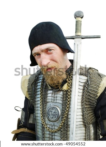 Man in an Historical enactment of Knight in armor - stock photo