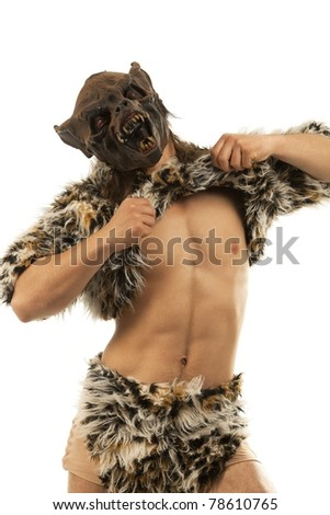 Man in an image of  snarling scary werewolfing  tearing away his pelt - stock photo