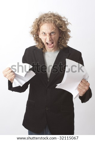 Man in anger breaking a paper #2