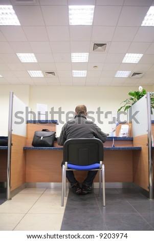 man in bank office - stock photo