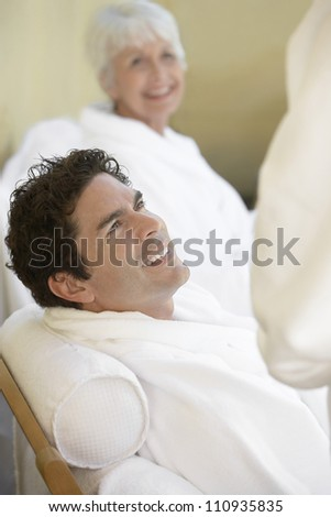 Man in bathrobe resting - stock photo