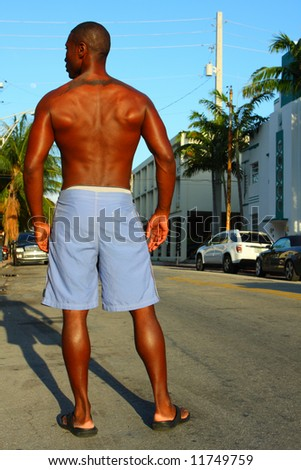 Man in beach shorts - stock photo