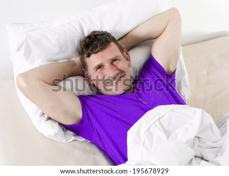 man in bed and smiling
