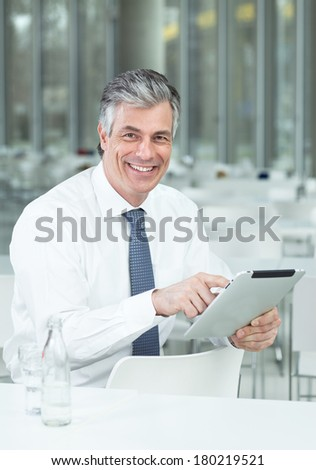 man in bistro with tablet