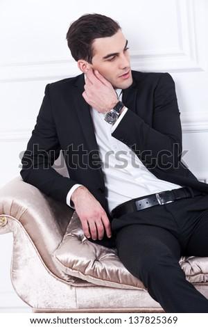Man in black dinner jacket with bow tie. Bridegroom - stock photo