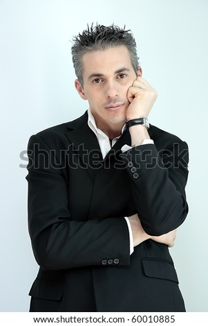 man in black jacket with his face resting on his hand - stock photo