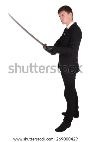 man in black suit and katana sword isolated on white - stock photo