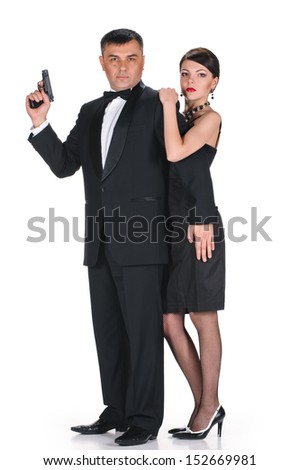 man in black suit and woman in black dress on white background - stock photo