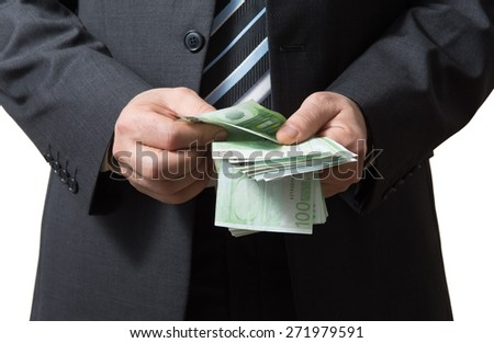 Man in black suit counts euro money - stock photo