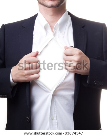 Man in black suit opening his white shirt revealing white copy-space for your text or images - stock photo