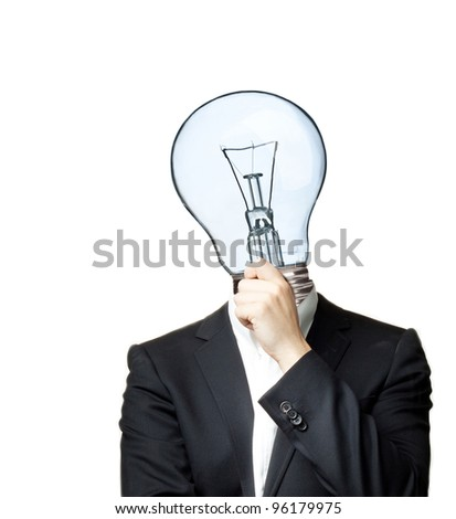 Man in black suit thinking (head replaced with light bulb) isolated on white background - stock photo