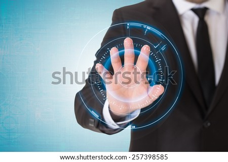 Man in black suit using virtual button on touch screen. - stock photo