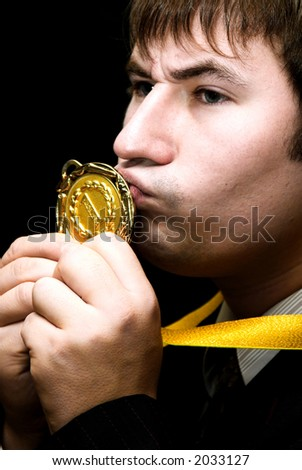 Man in black suit with award - stock photo