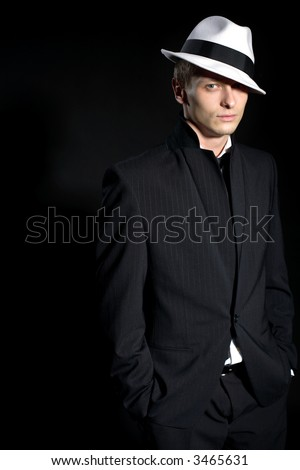man in black suite and white hat