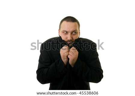 man in black with his head inside a black coat - stock photo