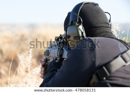 man in black  with weapon