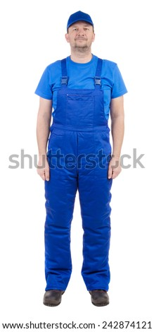 Man in blue overalls. Isolated on a white background. - stock photo