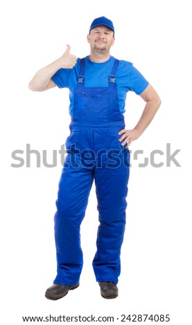 Man in blue overalls show ok sign. Isolated on a white background.