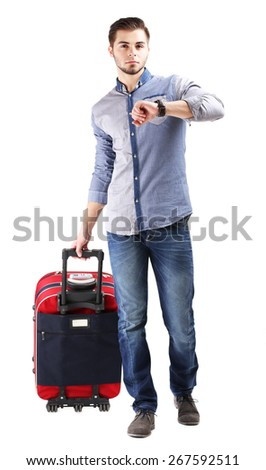 Man in blue shirt and jeans with suitcase isolated on white - stock photo