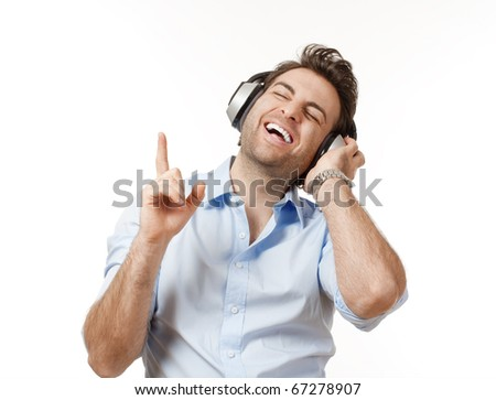 man in blue shirt with earphones listening to music - isolated on white - stock photo