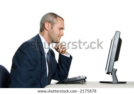man in blue suit looking at lcd monitor