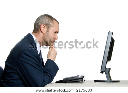 man in blue suit with tie analyzing lcd screen