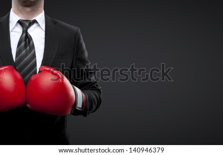 man in boxing gloves isolated on black - stock photo