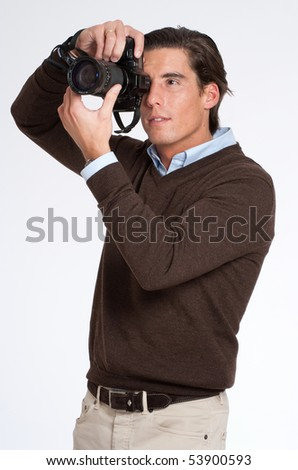 Man in brown taking a picture with a photo camera - stock photo