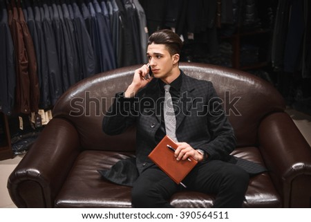 man in business style clothes waiting in the shop - stock photo