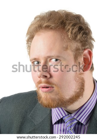 man in business suit looks suspectfully - stock photo