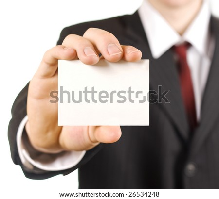 man in business suit showing blank card