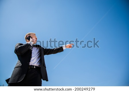 Man in business suit talking on mobile phone