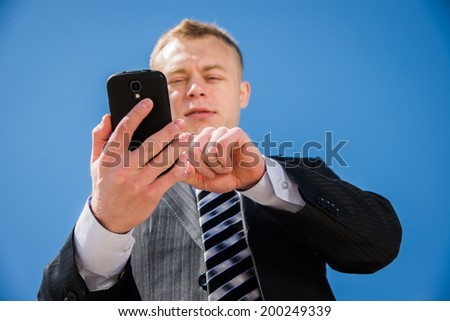 Man in business suit talking on mobile phone - stock photo