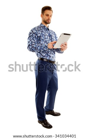 Man in bussines style uses the tablet