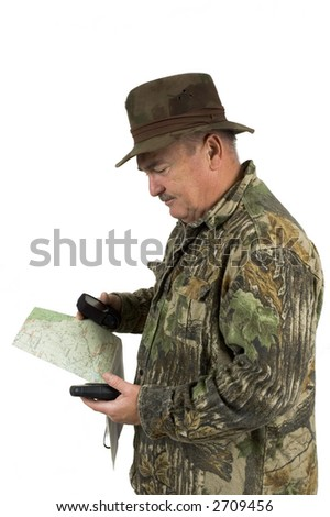 Man in Camouflage clothing using national forest maps and two gps's to check position on a white background
