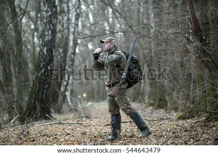 Man in camouflage on autumn hunting.
