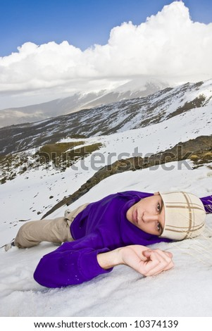 Man in casual clothing relaxed over the snow